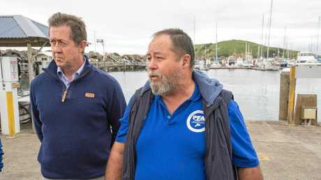 LIVELY MARKET: Federal Member for Cowper Luke Hartsuyker and chairman of Coffs Harbour's Professional Fishermen's Association Geoff Blackburn announce the launch of an 18 month feasibility study of the live export of eels to China.