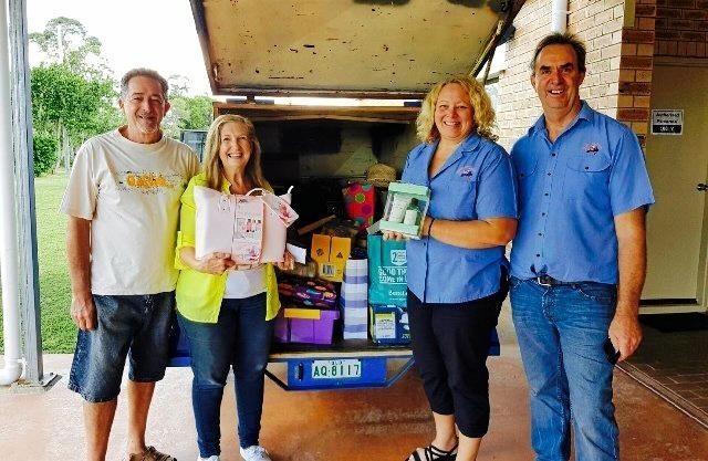 GENEROUS DONORS: Founders and directors from Care Outreach Australia Bill and Melissa Close (left) and Gympie's Charmaine and John Eastgate with a carload of goods donated to this year's We Care Mother's Day Hamper Appeal.