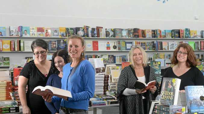 ANOTHER CHAPTER: The Book Warehouse Lismore owner, Sarah Morrow, with the team after the clean-up effort following the March flood.