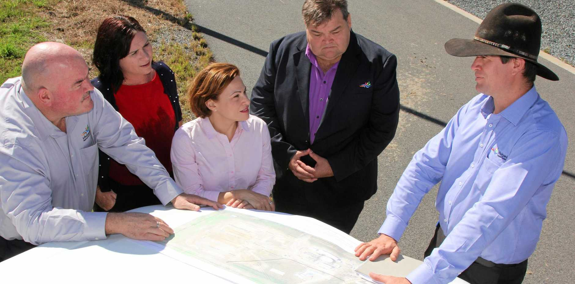 NEW WORK: Cr Mike Brunker, Whitsunday Labor candidate Bronwyn Taha, acting Queensland Premier Jackie Trad and Cr John Collins listen to council's manager of assets and planning Yestin Hughes at the Bowen water treatment facility near Proserpine during an announcement of solar project at the site.