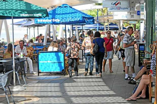 Mooloolaba Esplanade crowds enjoying the fine weather.