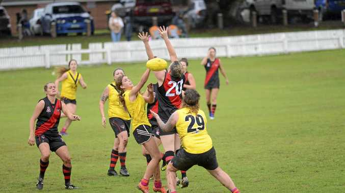 HISTORY MAKERS: AFL North Coast (yellow) fell agonisingly short of victory in the first ever womens AFL match in the region against the Ballina Bombers womens side.