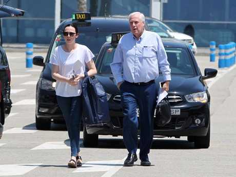 Clive Palmer and his daughter Emily in Barcelona where they boarded a $10,000 luxury cruise.