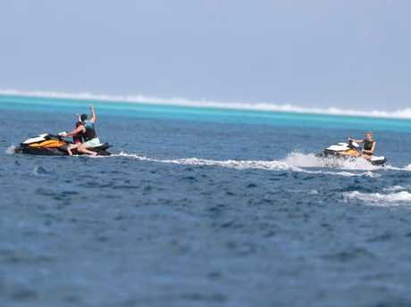 Karl rides ahead of Jasmine in the beautiful waters of Bora Bora.