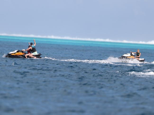 Karl rides ahead of Jasmine in the beautiful waters of Bora Bora.