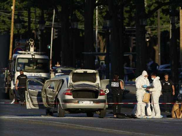 A man on the radar of French authorities was killed Monday after ramming a car carrying explosives into a police vehicle in the capital's Champs-Elysees shopping district, prompting a fiery blast, officials said.