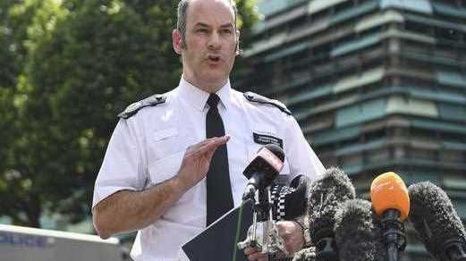 Metropolitan Police Commander Stuart Cundy speaks to the media near Grenfell Tower after a fire engulfed the 24-storey building, in London, Saturday June 17.
