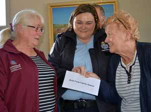 CONTRIBUTION: Julie Johnson and Betty Brennan present Bronagh Gillespie with $2000 in support of Brett Forte's family.