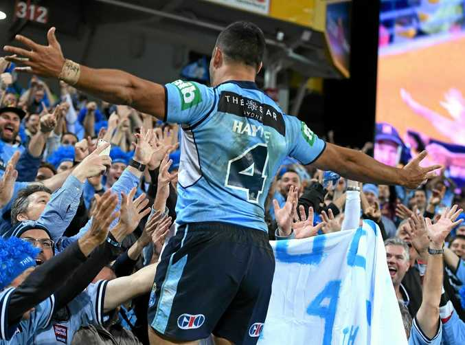 Jarryd Hayne of the NSW Blues reacts with fans after scoring a try during game one of the State of Origin series.