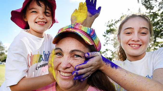 GET COLOURED: Charmaine Bailey with children Monique, 8, and Samantha, 17, get ready for the Colourburst Challenge at Seafront Oval.