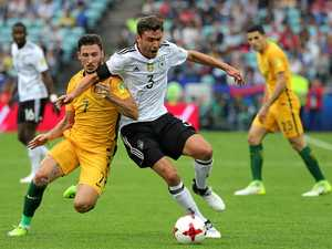 Socceroos push world champions in Cup opener