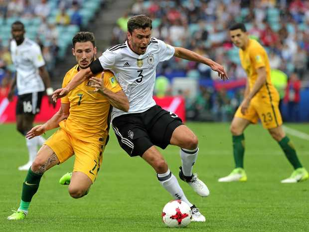 Australia's Mathew Leckie (left) and German rival Jonas Hector vie for possession in their FIFA Confederations Cup 2017 group B soccer match in Sochi.