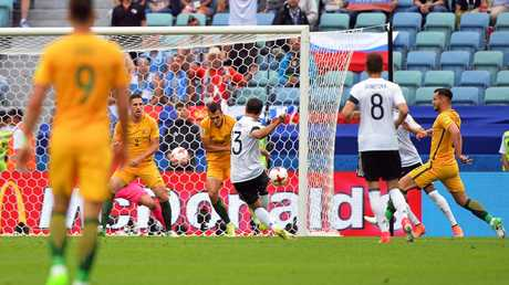 Germany's Lars Stindl scores the opening goal against Australia in their Confederations Cup match.