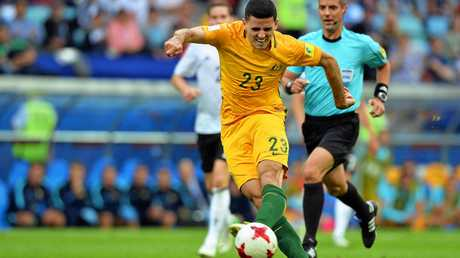 Tommy Rogic scores Australia's opening goal in the Confederations Cup clash against Germany.