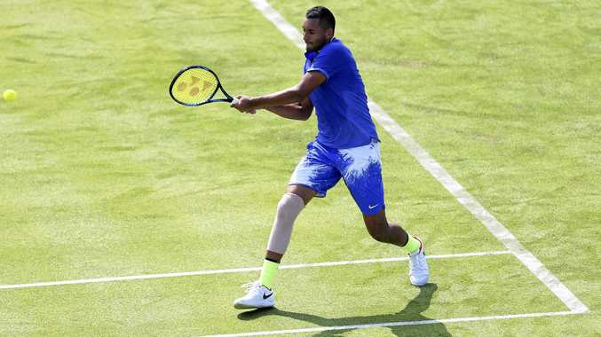 Nick Kyrgios fires a forehand return in the match against American Donald Young on day one of the Queen's Club Championships in London.