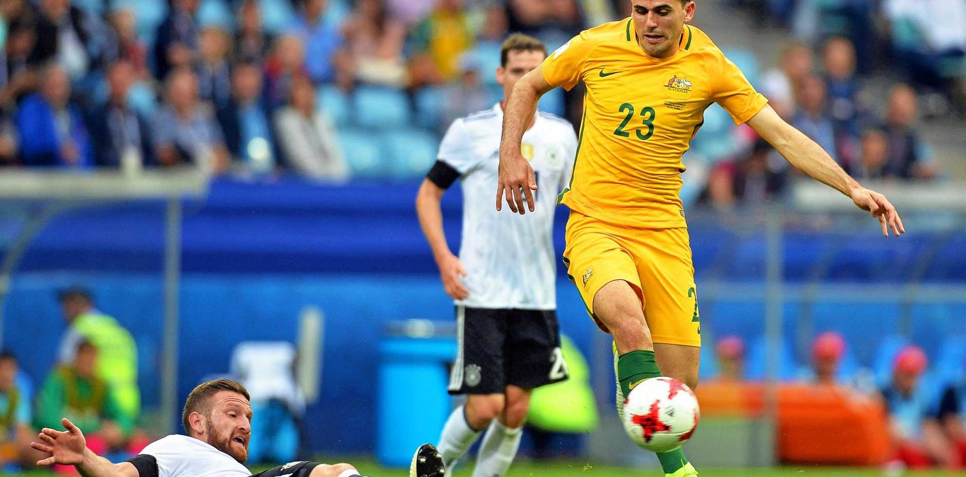 Australia's Tommy Rogic leavees Germany's Shkodran Mustafi in his wake duirng their FIFA Confederations Cup opener in Sochi.