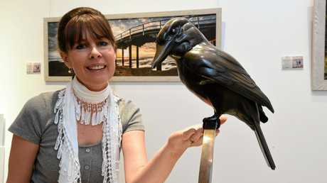 Sculptor Elizabeth Hersey with one of the pieces from her Captured in Bronze exhibition.