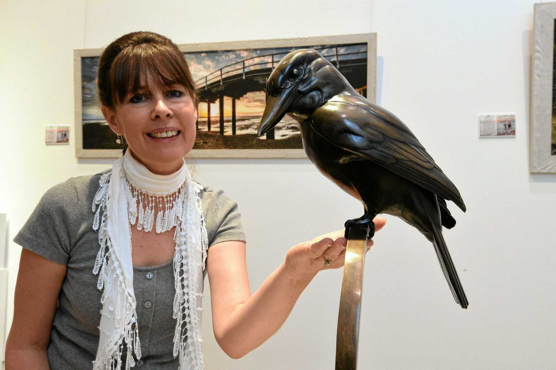 Hervey Bay Regional Gallery - sculptor Elizabeth Hersey with one of the pieces from her