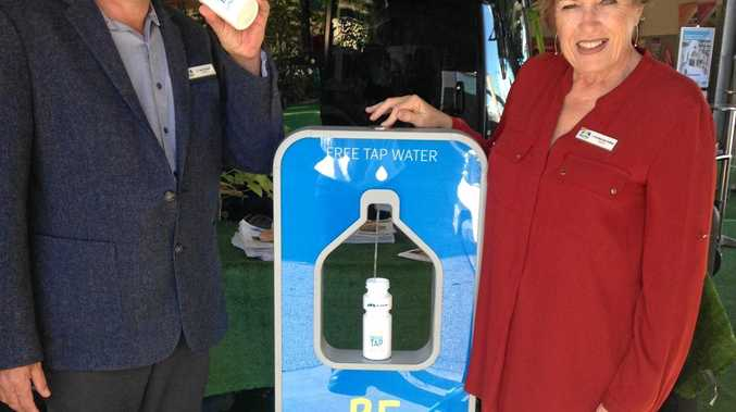 WATER FOR FREE: Councillors Ayril Paton and Fran Mann handed out free tap water at the Mackay Show yesterday.