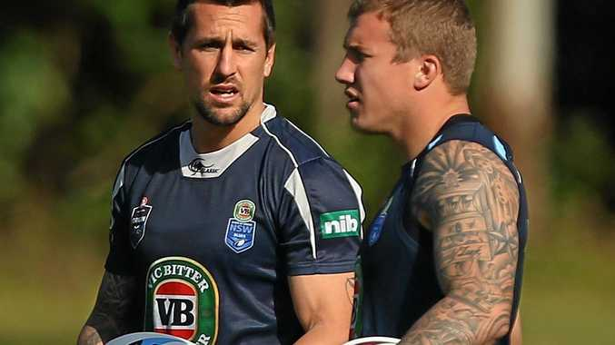 THAT WAS THEN: Mitchell Pearce and Trent Hodkinson talk during a Blues training session 2015 in Coffs Harbour.