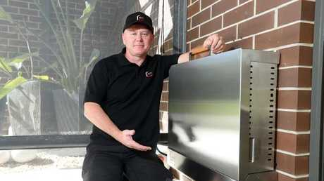 Gold Coast plumber Ryan Martin has just completed the first year of sales since launching his world first wall-mounted foldaway barbecue.