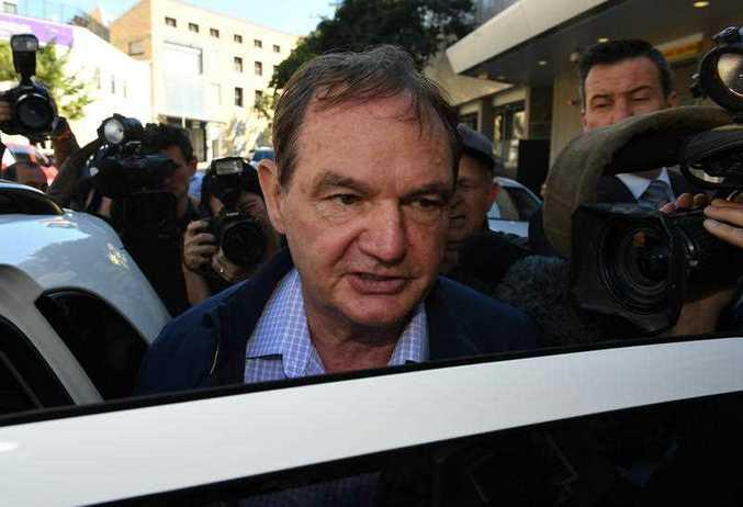 Former Ipswich mayor Paul Pisasale leaves the police watch house in Brisbane.