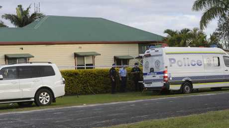 Police search the house of John Edwards house in Lawrence following his arrest in Redcliffe Queensland for the alleged murder of Sharon Edwards.