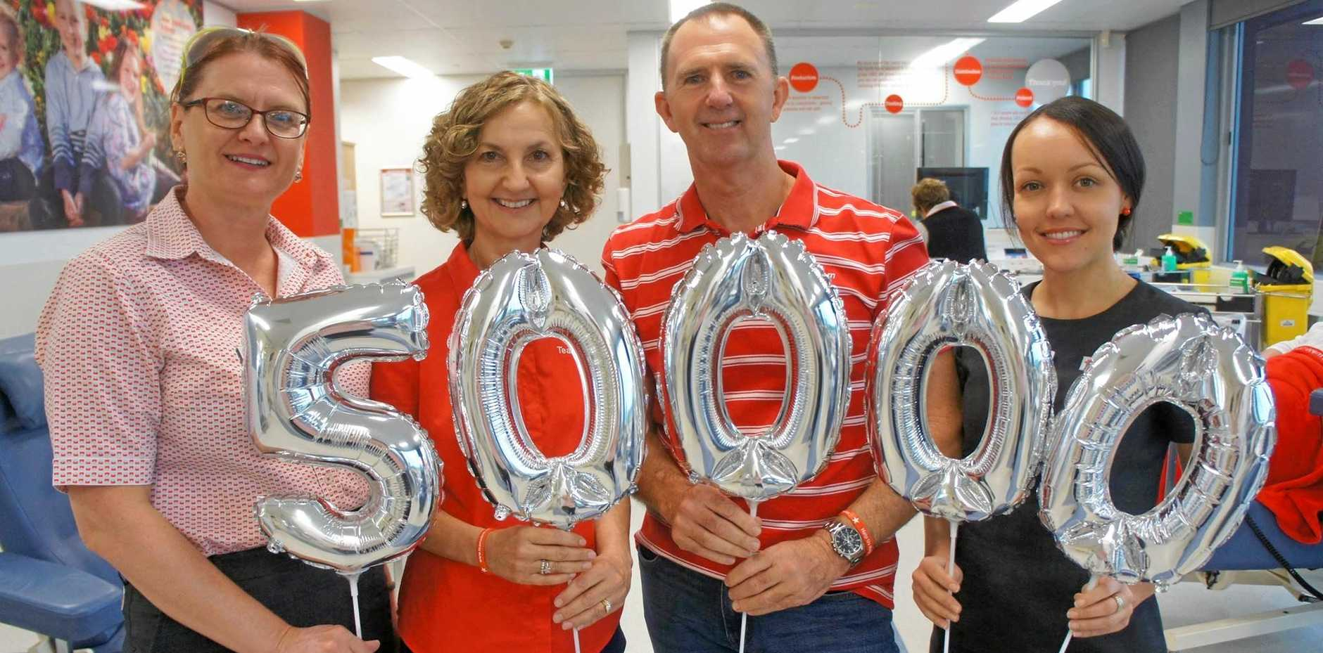 50,000 SMILES: Brent and Lu Crosby celebrate their milestone achievement with staff from the Maroochydore Red Cross donor centre.