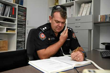 OFICE WORK: Acting Station Officer Mark St Ledger goes through the file logs at the Bundaberg Fire and Rescue Station.