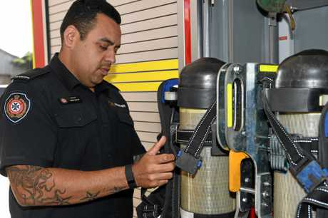 CHECKING GEAR: Fire Fighter Trent Sailor at the Bundaberg Fire and Rescue Station.