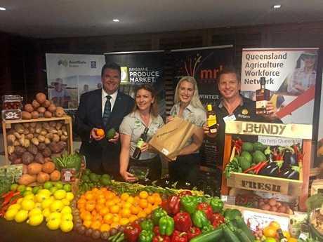 Member for Burnett Stephen Bennett, Kylie Jackson and Bree Grima from Bundaberg Fruit and Vegetable Growers and Duncan Littler from Bundaberg Rum at the Bundaberg Region Promotion Night.