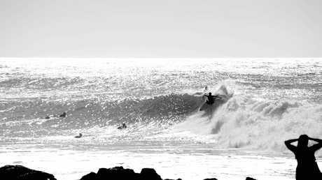 Julian Wilson enjoying the surf at Coolum Beach.