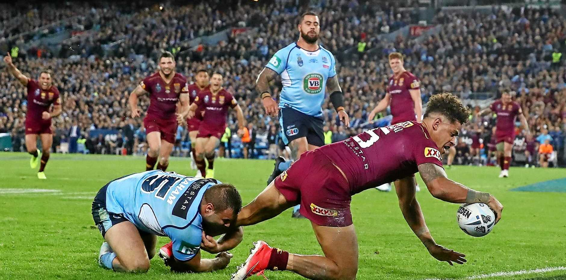 Dane Gagai of the Maroons scores the winning try.