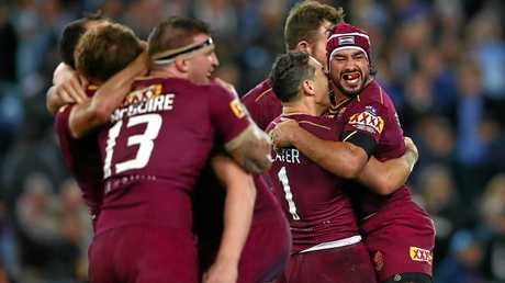 Johnathan Thurston (right) celebrates after kicking the winning goal.