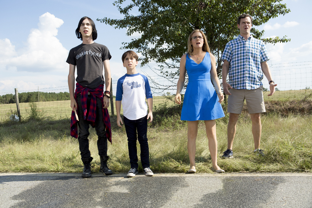 Charlie Wright, Jason Drucker, Alicia Silverstone and Tom Everett Scott in a scene from the movie Diary of a Wimpy Kid: The Long Haul.