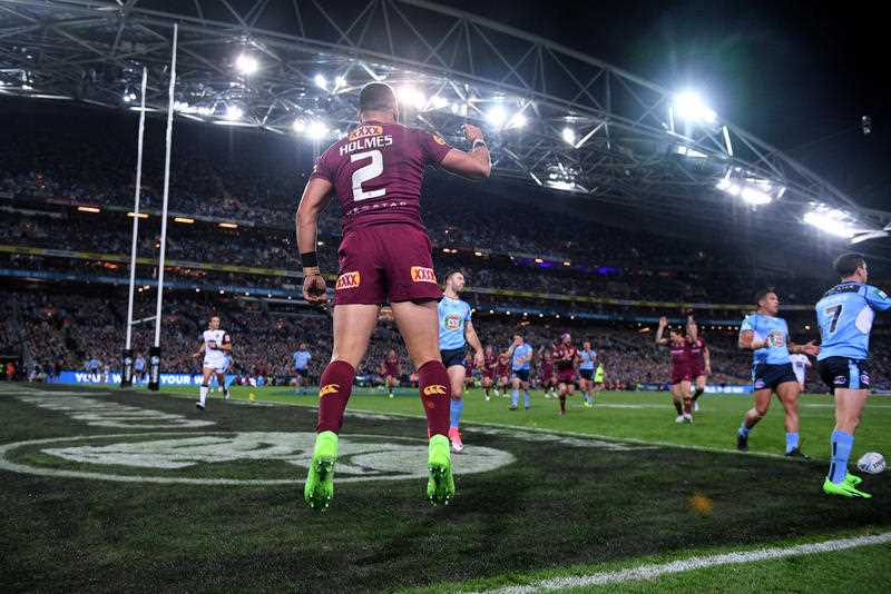 Valentine Holmes of the Maroons, (centre), celebrates after scoring a try during State of Origin Game II between the NSW Blues and Queensland Maroons, at ANZ Stadium in Sydney on Wednesday, June 21, 2017.