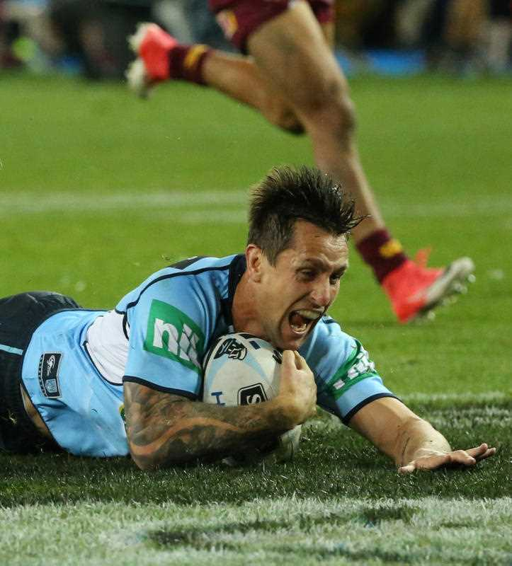 Mitchell Pearce of the Blues celebrates scoring a try during State of Origin Game II between the NSW Blues and Queensland Maroons at ANZ Stadium in Sydney on Wednesday, June 21, 2017.