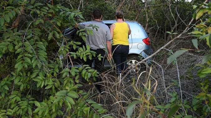 Car in bush at crash site on Branyqn Drive