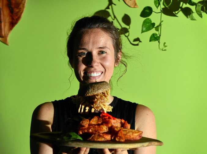 CHANGING PALATE: Manager of Elixiba Sarah Hutto with one of their vegan burgers.