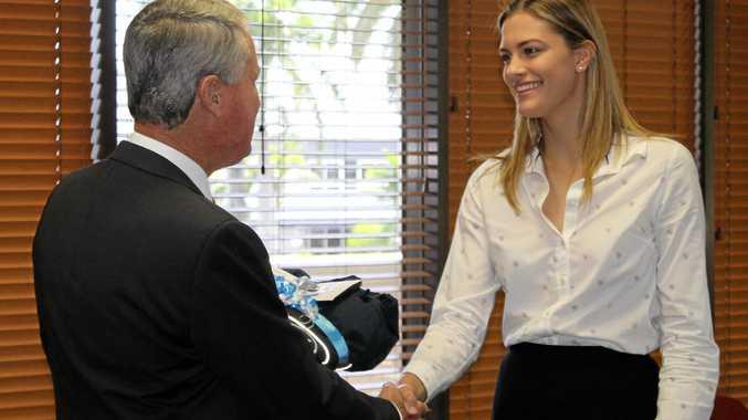One of last year's bursary recipients, Lauren Bella, recieving her bursary from Mackay Mayor Greg Williamson.