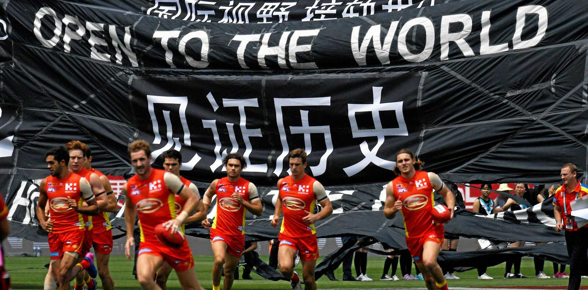 Suns and Port players run on to Jiangwan Stadium, Shanghai on May 14, 2017. Picture: Tracey Nearmy/AAP