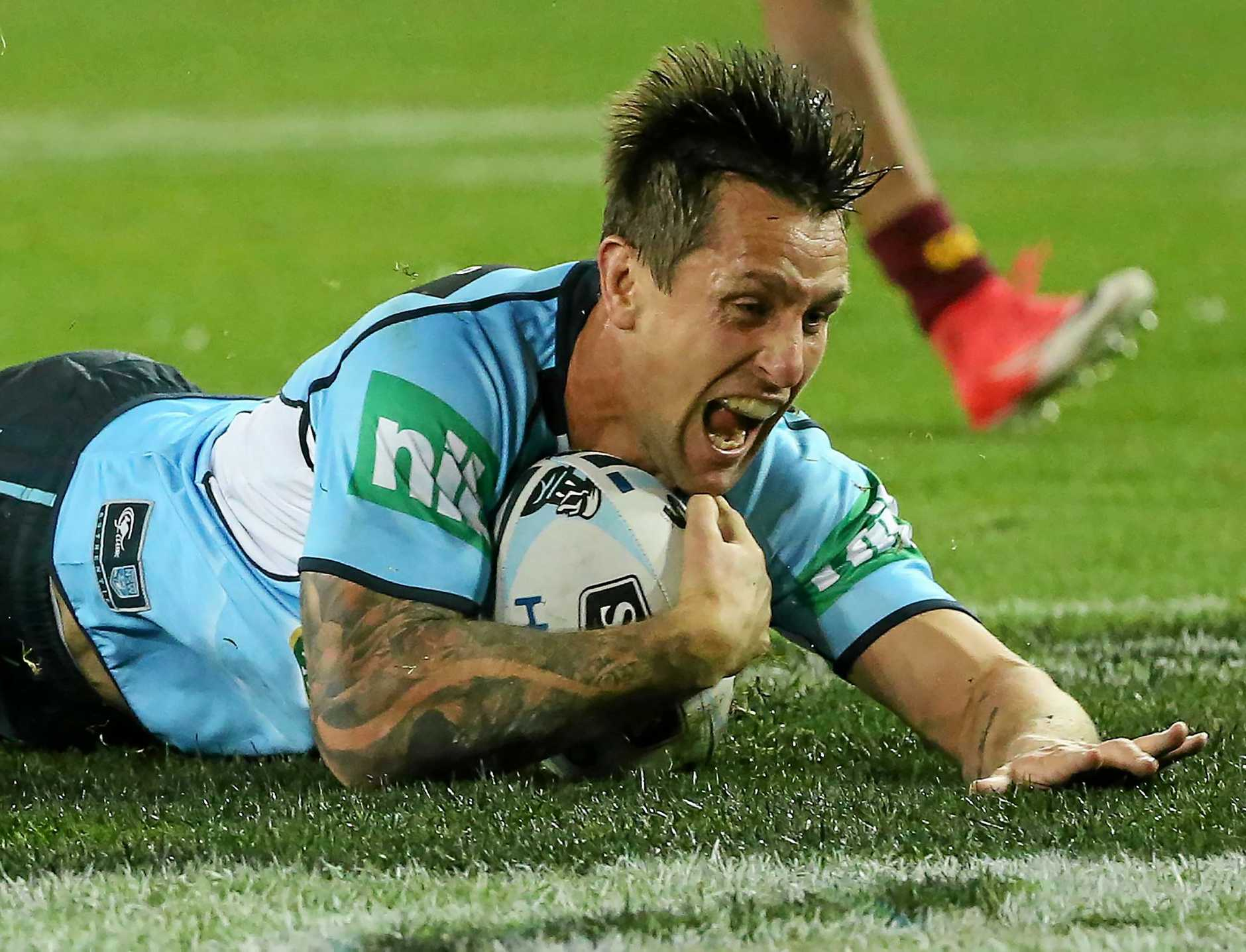 Mitchell Pearce of the Blues celebrates scoring a try during State of Origin game two.