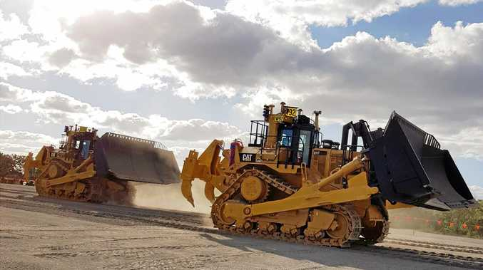 WAY OF FUTURE: Toowoomba based Wolff Group is the first company in Australia to showcase driverless dozers. INSET: The control room where operators control the dozers.