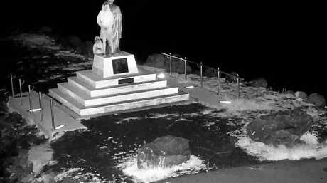 CCTV photo of two males vandalising the St Peter's statue.