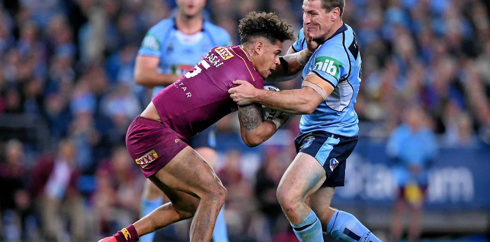 Dane Gagai of the Maroons is tackled by Josh Jackson of the Blues.