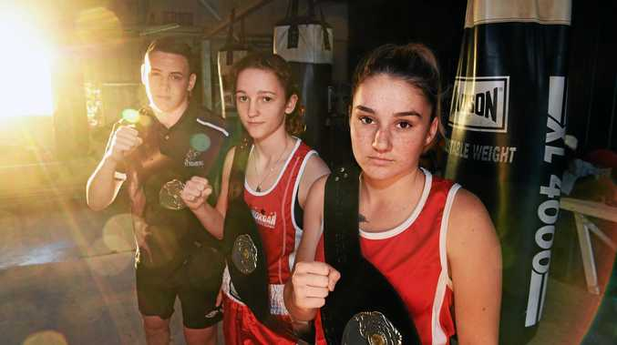 BOXING: Blaze Wise, Chantelle Whelan and Brittany Roll with their Wide Bay Boxing Belts.