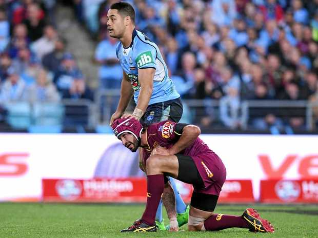 Jarryd Hayne (left) of the Blues pats Johnathan Thurston of the Maroons on the head.