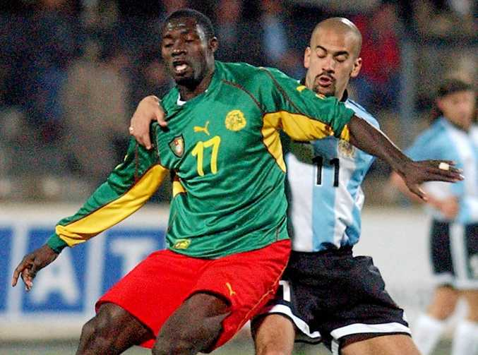 Cameroon's Marc Vivien Foe (left) fights for the ball with Argentina's Juan Veron in 2002.