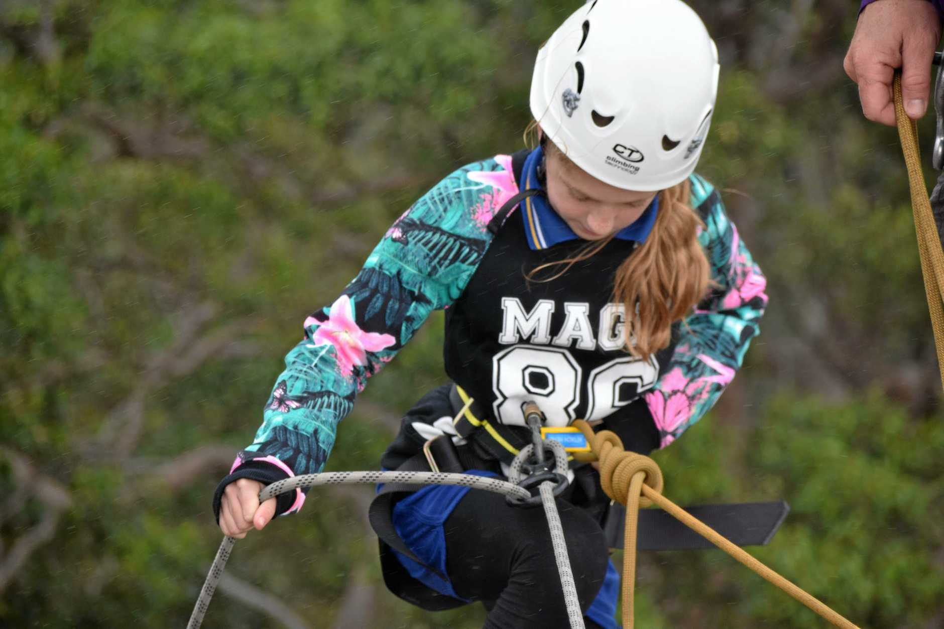 BRAVE SOULS: Ella Grandcourt (above left) is a picture of concentration on her descent down Mt Tinbeerwah recently, while Hayley Siewert (above right) seems to be thoroughly enjoying the experience.