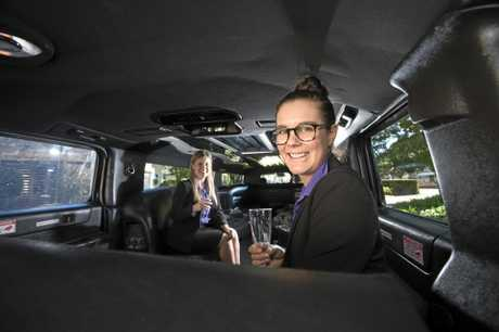 FOODIE CULTURE: Emily Moon (left) and Cheryse Bliesner with the Hummer used for Toowoomba's Luxury Food and Wine Tour.